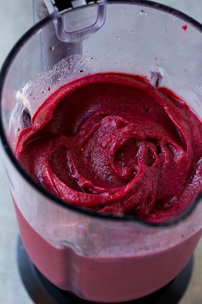 Frozen fruit smoothie in a blender.
