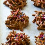 Haystack cookies made with chow mein noodles on a baking sheet.