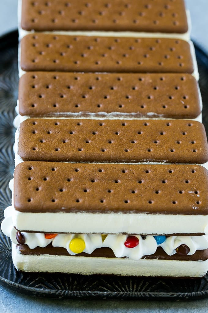 Ice cream sandwich cake dinner at the zoo layers of an ice cream sandwich cake with whipped topping and chocolate candy ccuart Choice Image