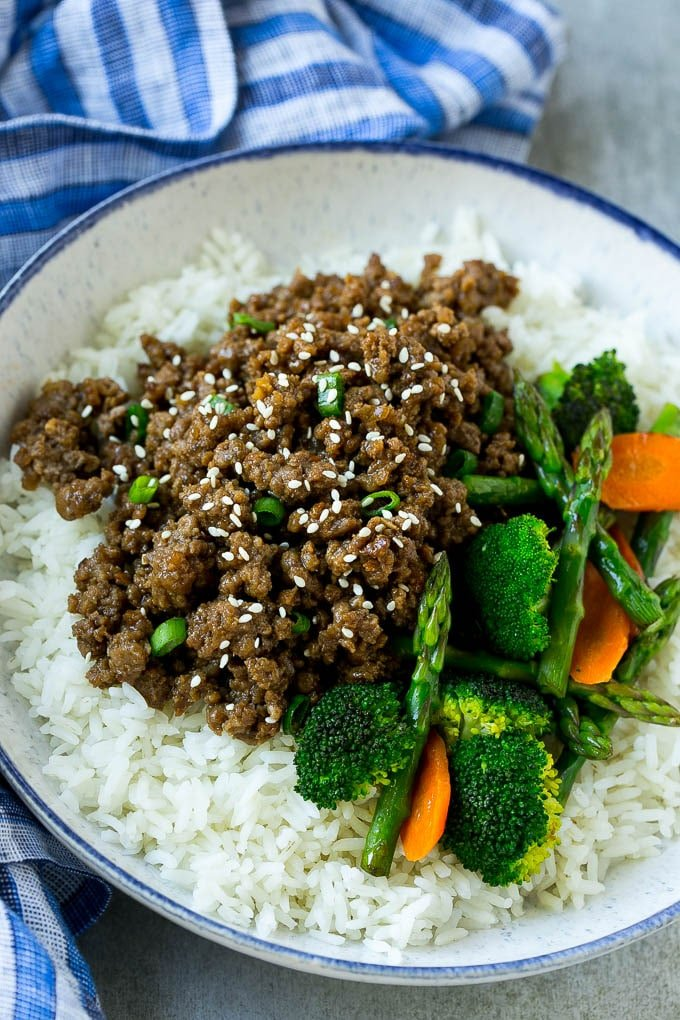 A bowl of rice topped with Korean ground beef and mixed vegetables.