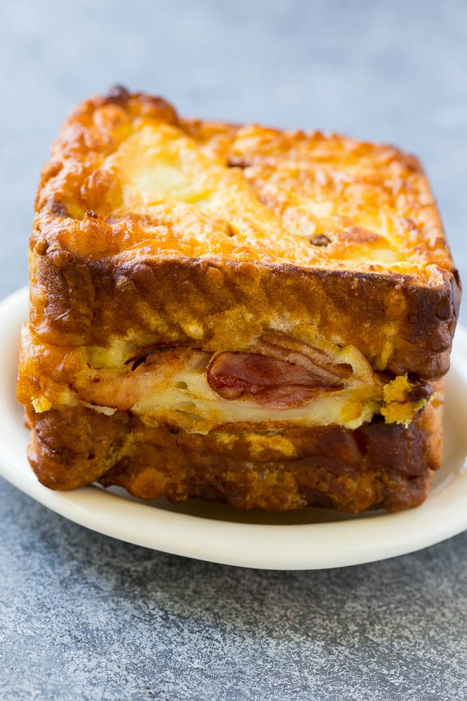 A Monte Cristo sandwich with layers of turkey, ham and cheese.