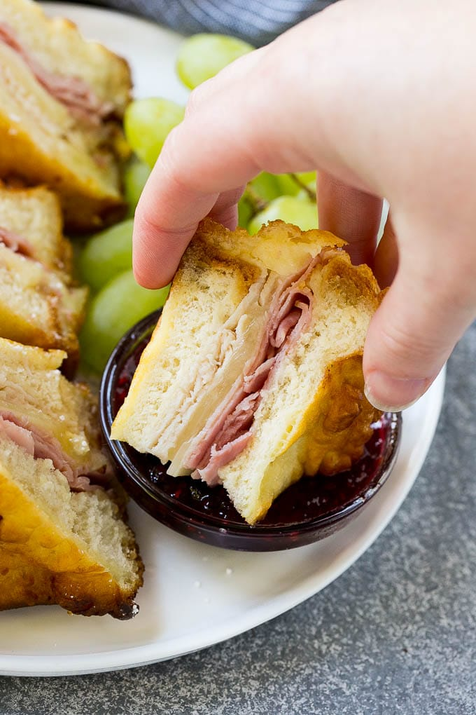 Monte Cristo Sandwich dipped in raspberry jam.