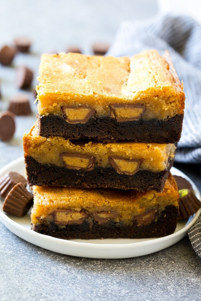 A stack of peanut butter chocolate gooey butter cake slices.