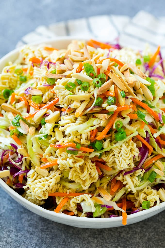 Ramen noodle salad full of shredded cabbage, sliced almonds, carrots and green onions.