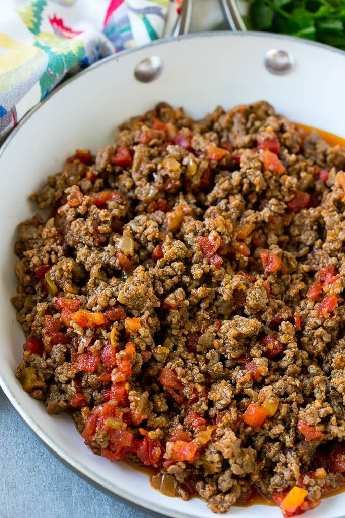 A skillet of cooked ground beef and tomatoes.