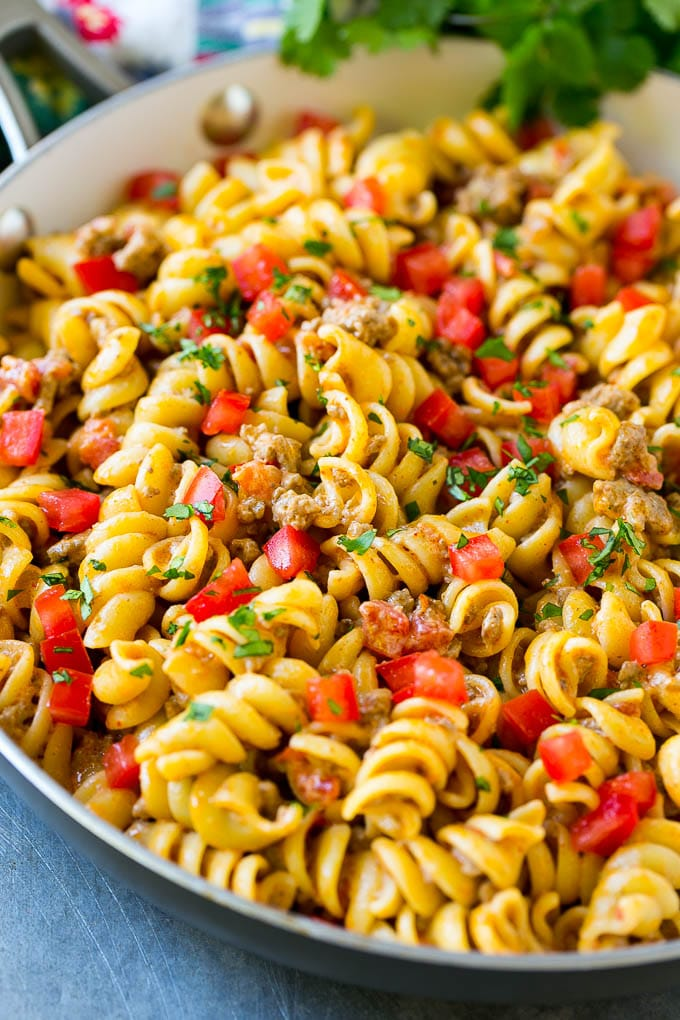 This taco pasta is loaded with ground beef, cheese and tomatoes, then garnished with fresh cilantro.