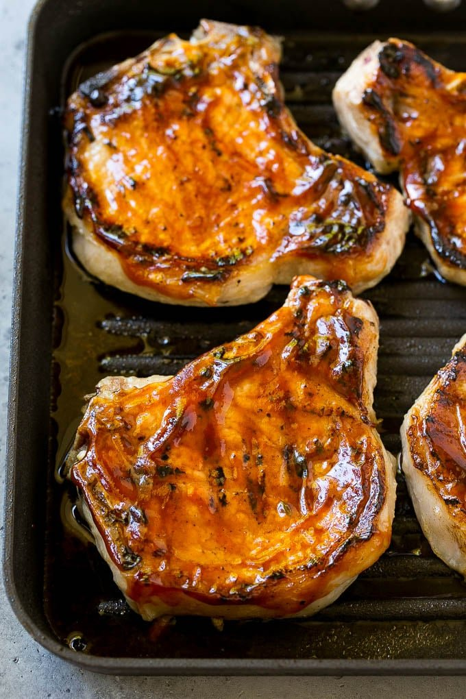 Grilled pork chops brushed with BBQ sauce.