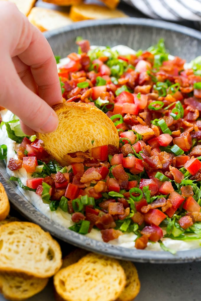 BLT dip with bacon, lettuce, tomato and green onions over a creamy ranch dip.