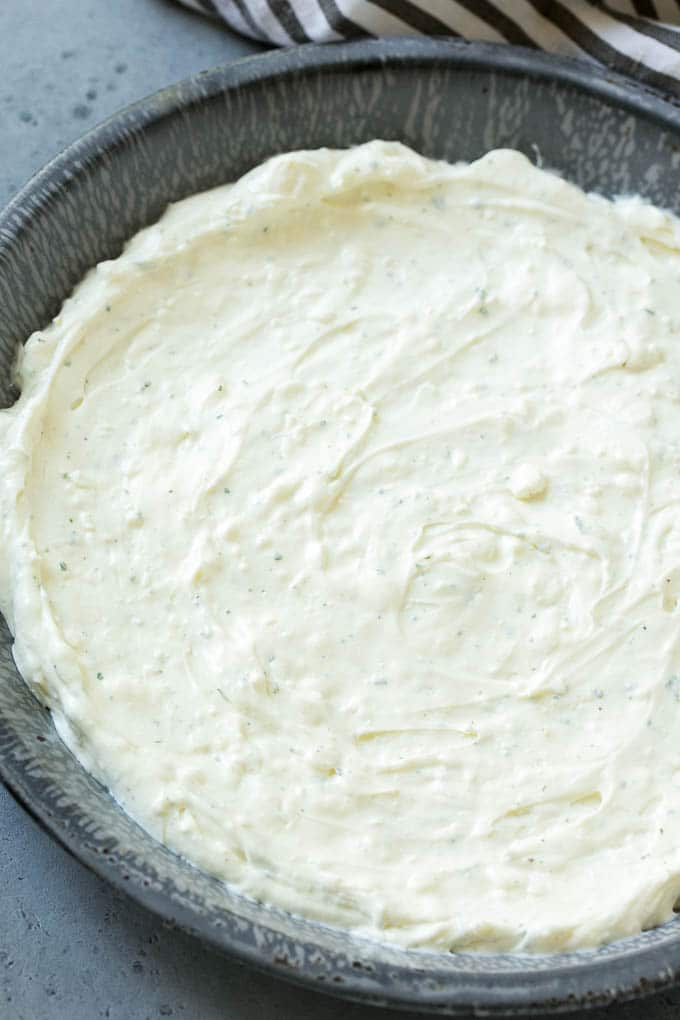 A layer of cream cheese and sour cream mixed with ranch seasoning.