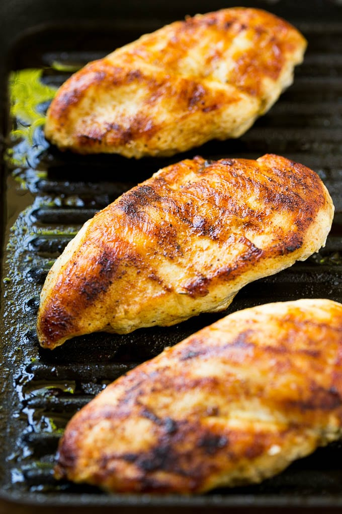 Cooked chicken in a grill pan.