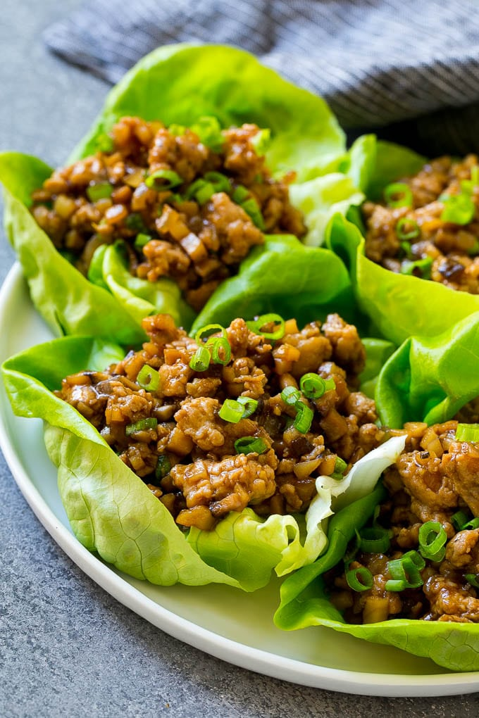 Chicken lettuce wraps with seasoned ground chicken stuffed into butter lettuce leaves.