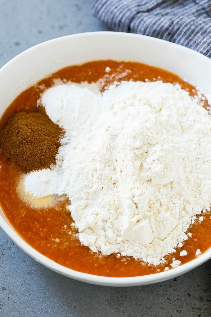 Pumpkin, flour, baking powder and cinnamon in a mixing bowl.