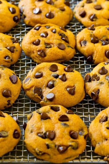 Pumpkin chocolate chip cookies on a cooling rack.