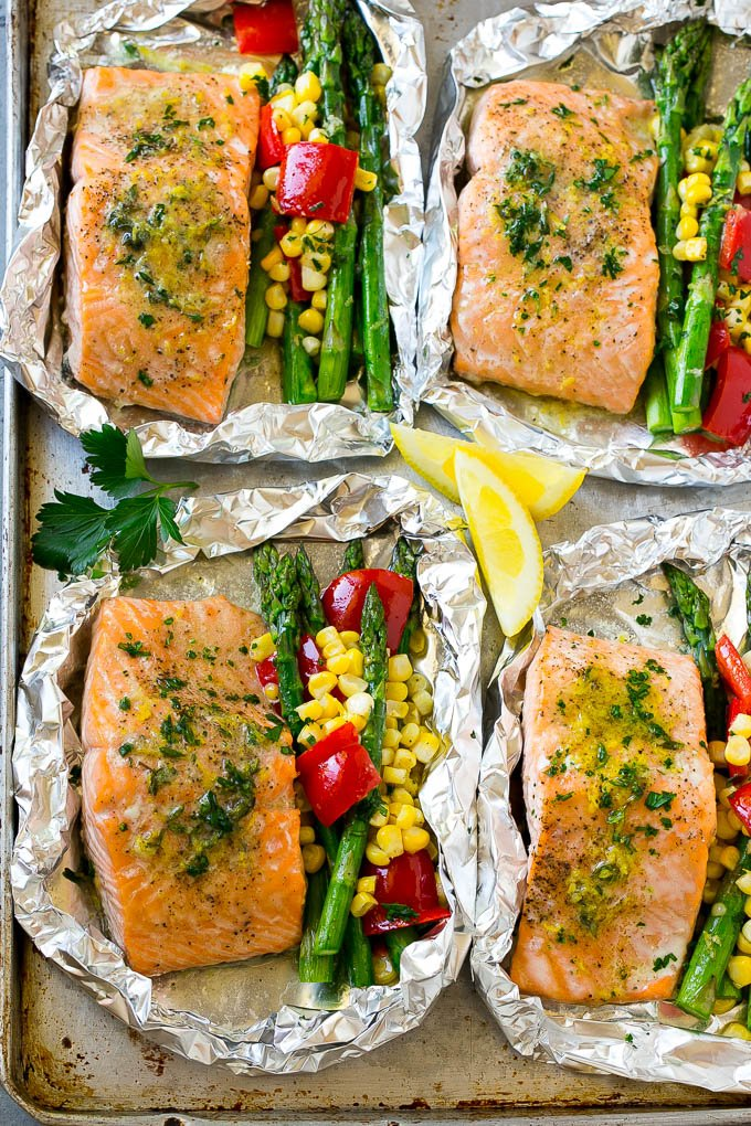 Salmon foil packets in herb butter with vegetables.