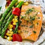 A salmon foil packet that can be baked or grilled with seasoned salmon and fresh vegetables.
