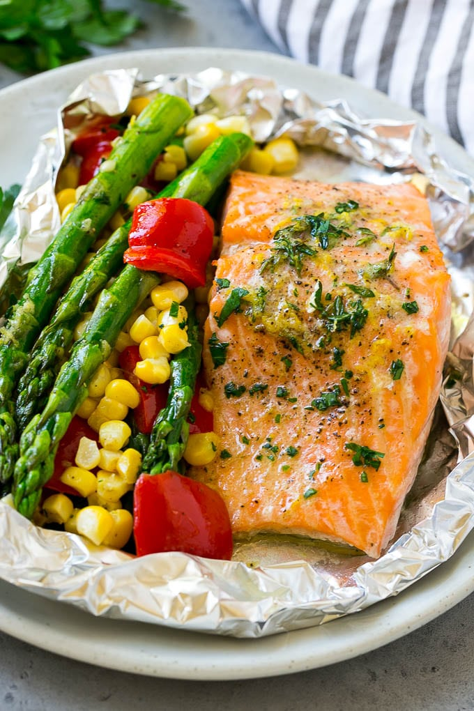Salmon foil packets that can be baked or grilled with seasoned salmon and fresh vegetables.