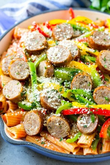Sausage and pepper pasta with sliced Italian sausage, red and yellow bell peppers and grated parmesan cheese.