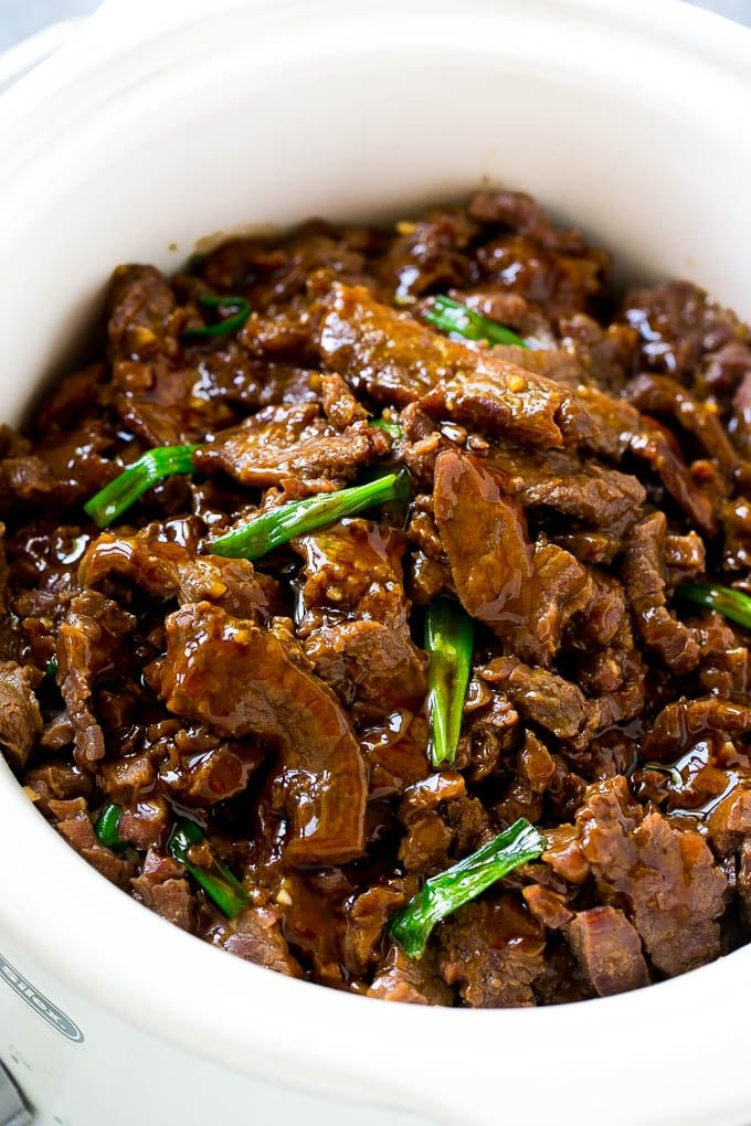 Slow cooker mongolian beef with thinly sliced flank steak cooked with soy sauce, brown sugar, garlic and ginger.