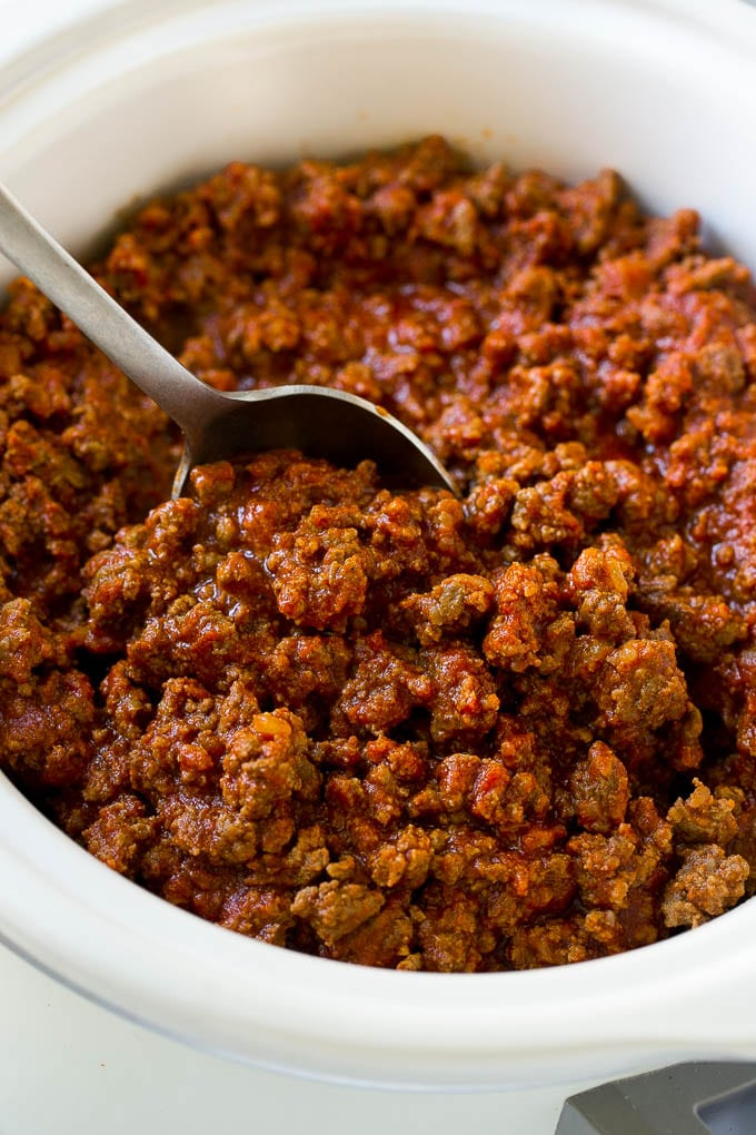 Slow cooker sloppy joe meat with a serving spoon.