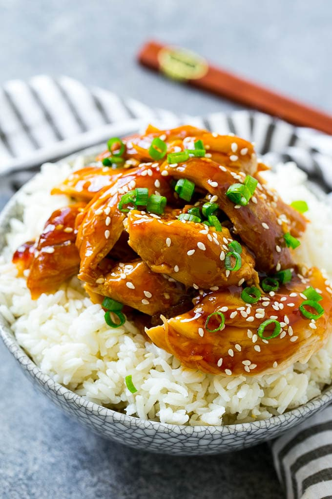 Shredded slow cooker teriyaki chicken served over rice.