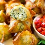 Spinach artichoke wontons with homemade spinach artichoke dip stuffed into wonton wrappers and fried.