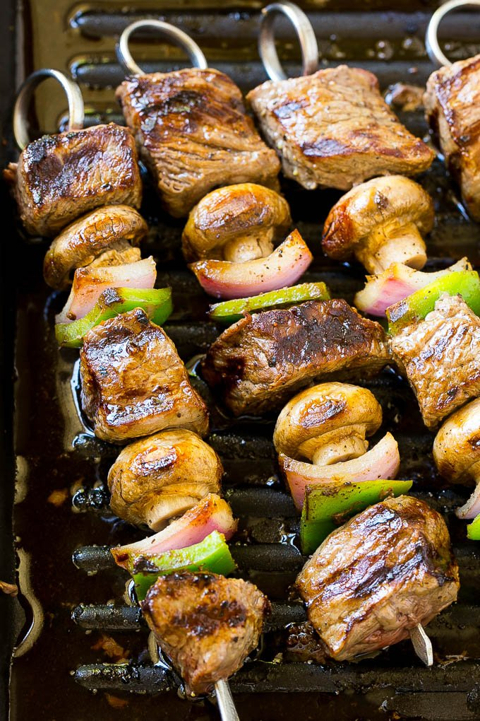 Steak kabobs on a grill pan.