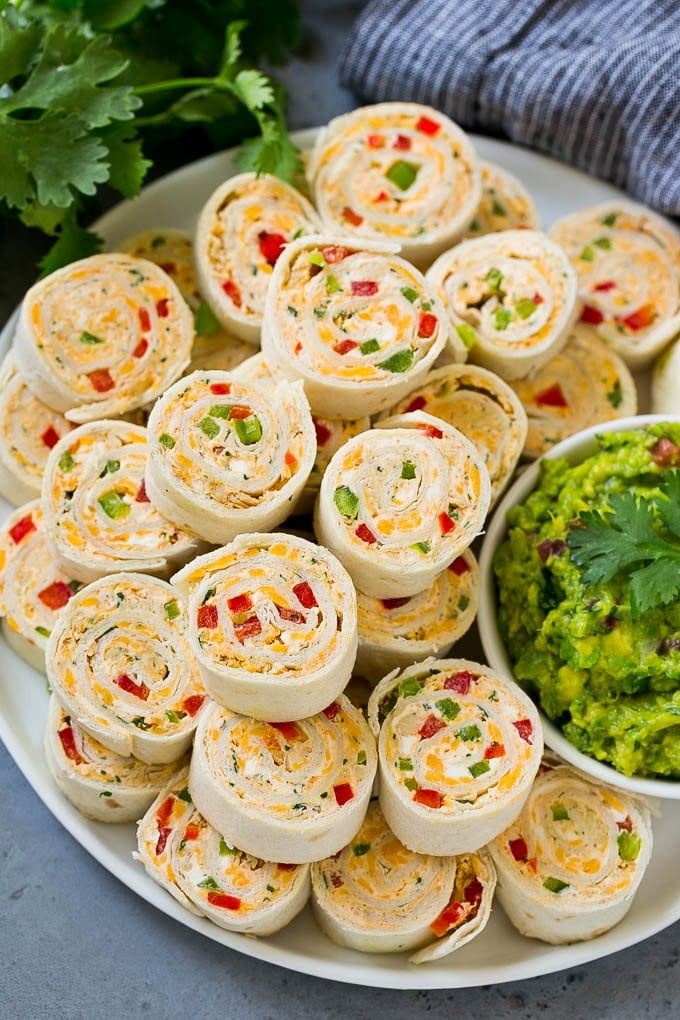 Taco pinwheels made with cream cheese, chicken, cheddar cheese and bell peppers.