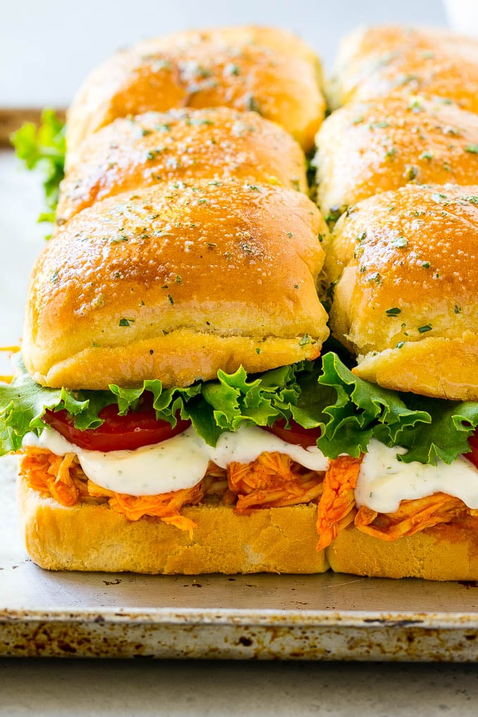 Buffalo chicken sliders with shredded buffalo chicken, lettuce, tomato and ranch sauce.