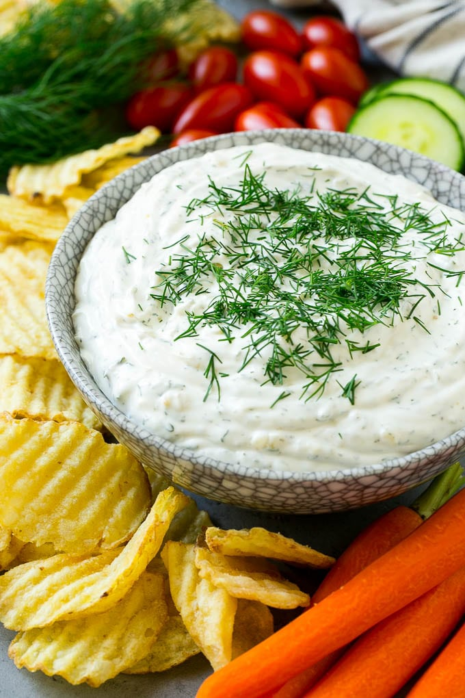 Easy dill dip in a serving bowl garnished with fresh dill.
