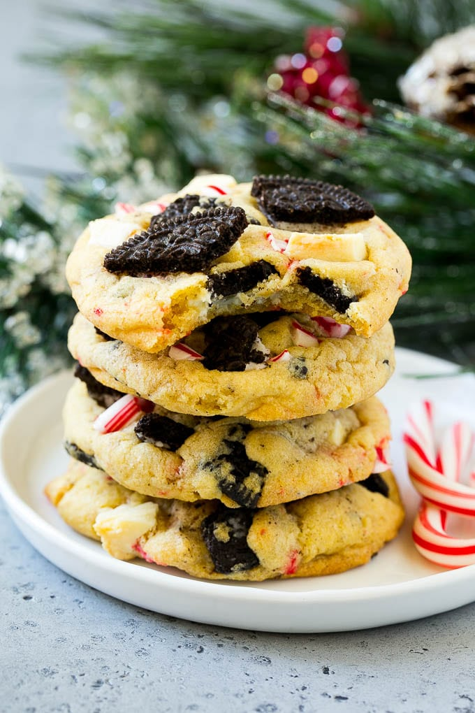 A stack of Oreo peppermint cookies on a plate, garnished with candy canes.