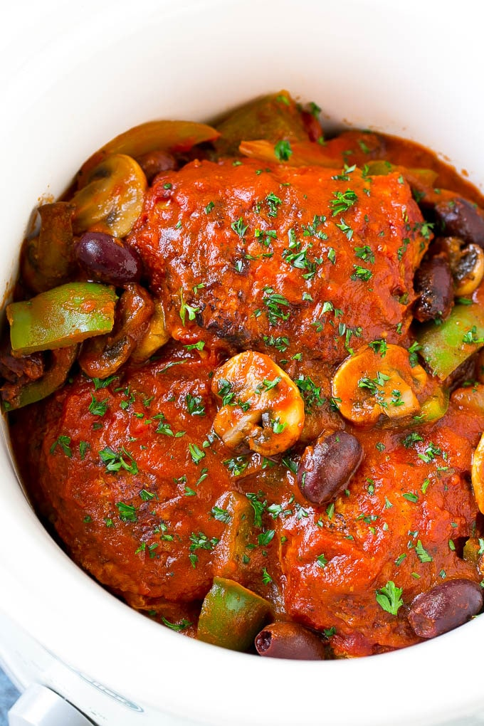 Slow cooker chicken cacciatore with mushrooms, peppers, olives and onions.