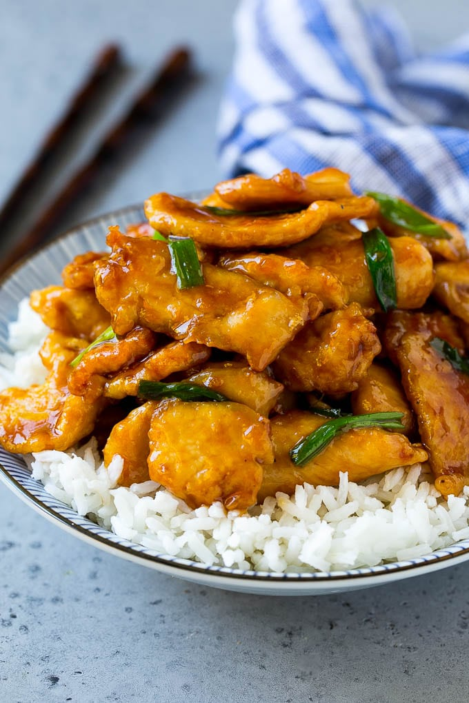 Mongolian chicken served over a bowl of rice.
