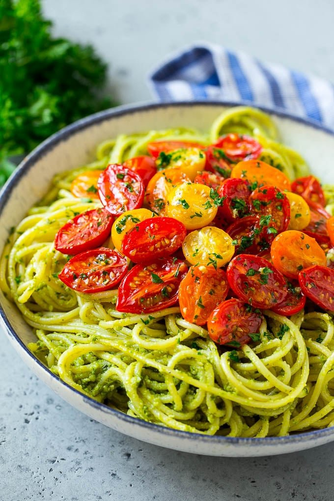 Pesto pasta topped with roasted cherry tomatoes.