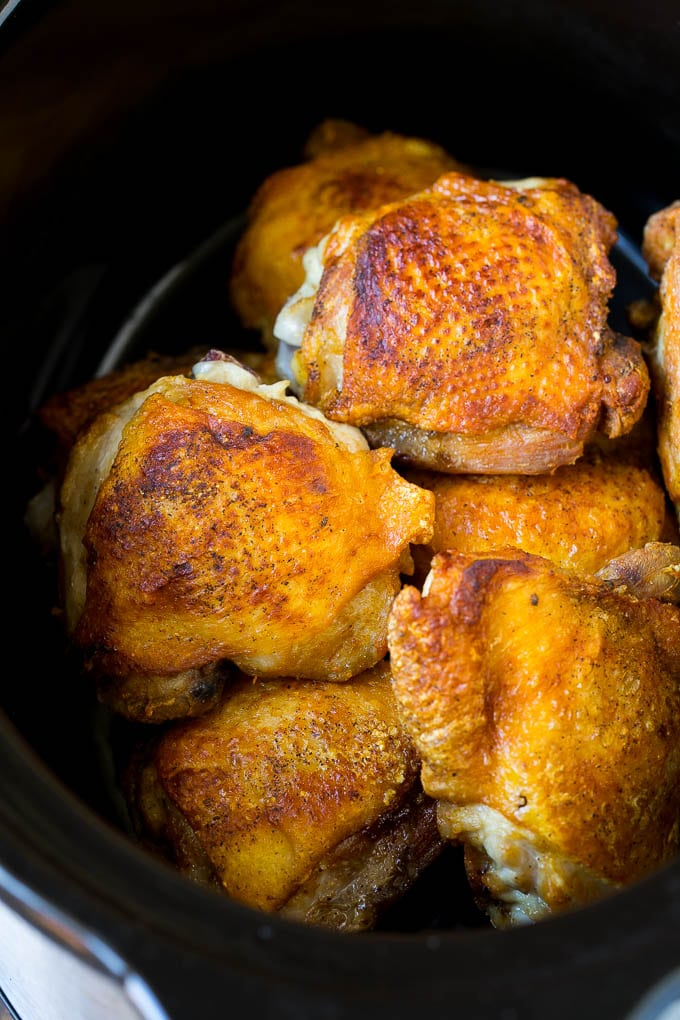 Browned chicken thighs in a crock pot.