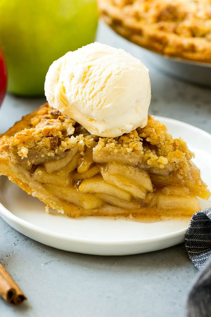 A slice of dutch apple pie made with homemade apple pie filling.