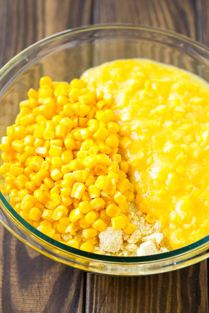 Corn kernels, creamed corn and cornbread mix in a bowl.