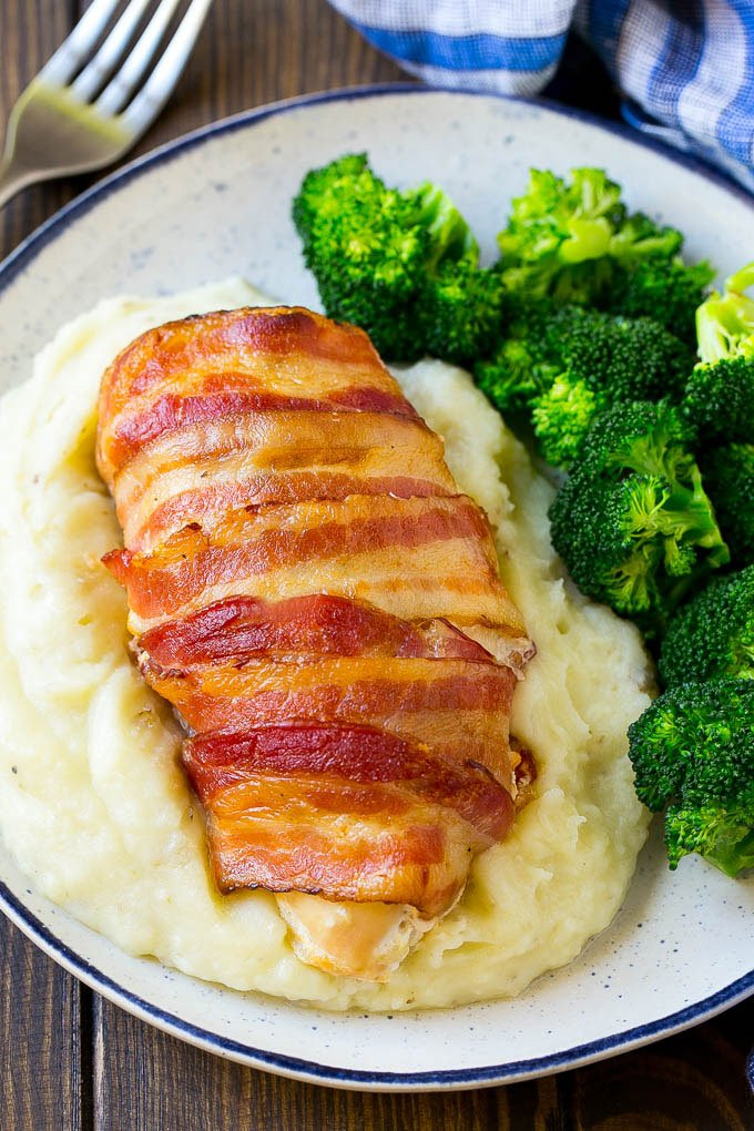 Bacon wrapped jalapeno popper chicken served with mashed potatoes and broccoli.