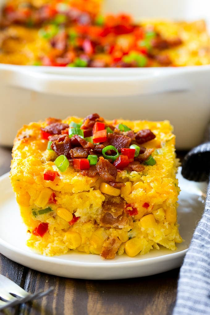 A serving of corn casserole filled with bacon, cheese and peppers.
