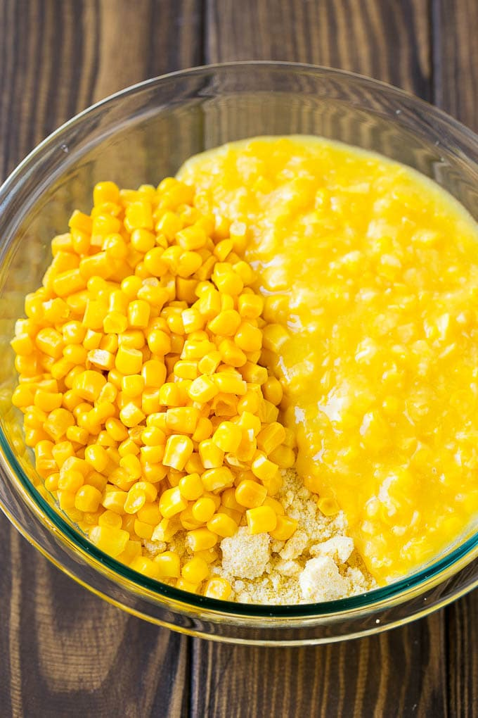 Cornbread mix, corn and creamed corn in a mixing bowl.