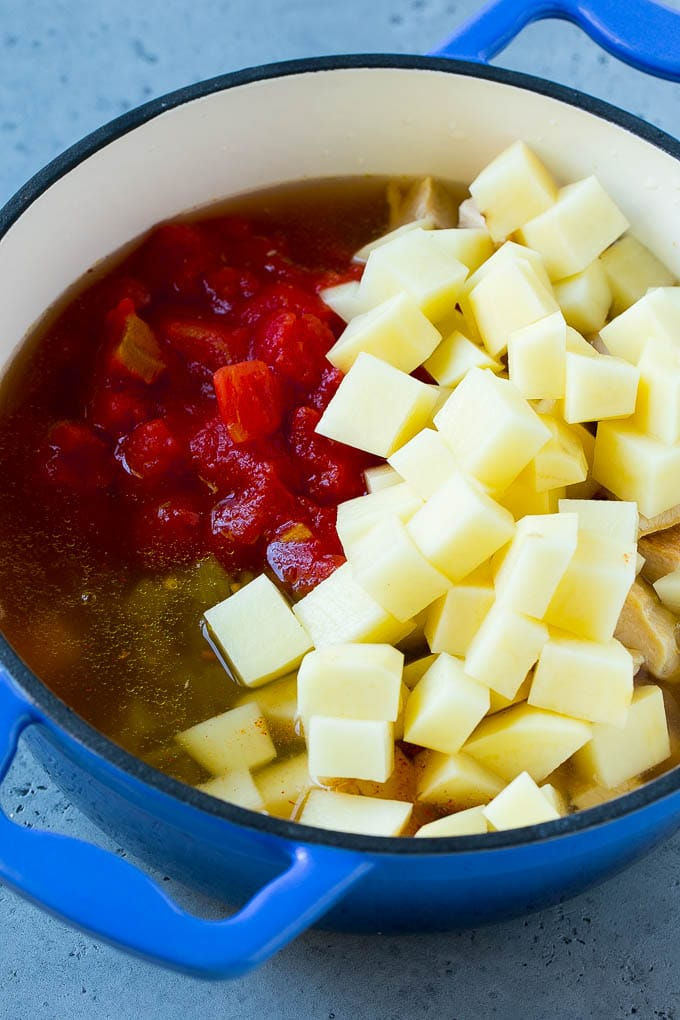 Mexican chicken soup with diced potatoes, tomatoes, chicken and vegetables.