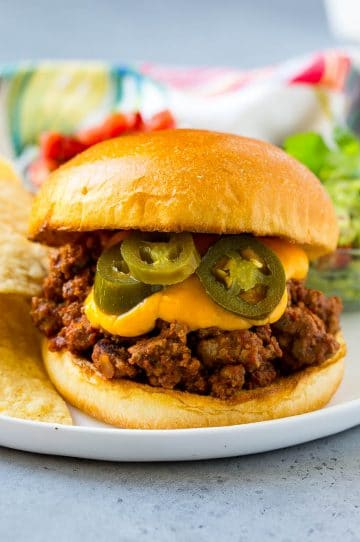 Nacho sloppy joes with ground beef, cheese sauce and jalapenos.