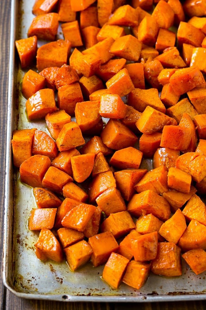 A sheet pan of roasted sweet potatoes.