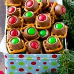 A gift tin full of Christmas colored Rolo pretzels.