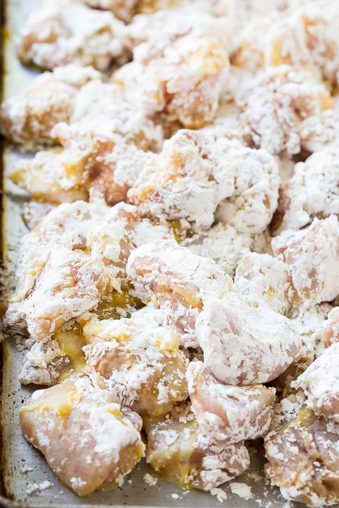 Chicken pieces coated in egg and flour.