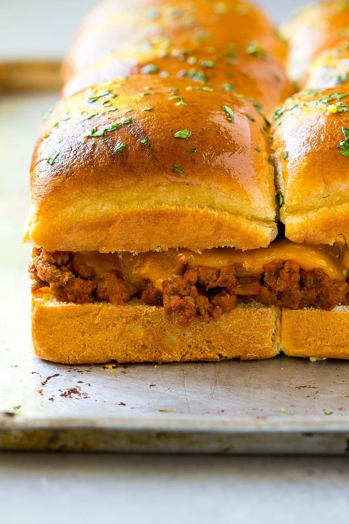 Ground beef and melted cheddar cheese on slider buns.