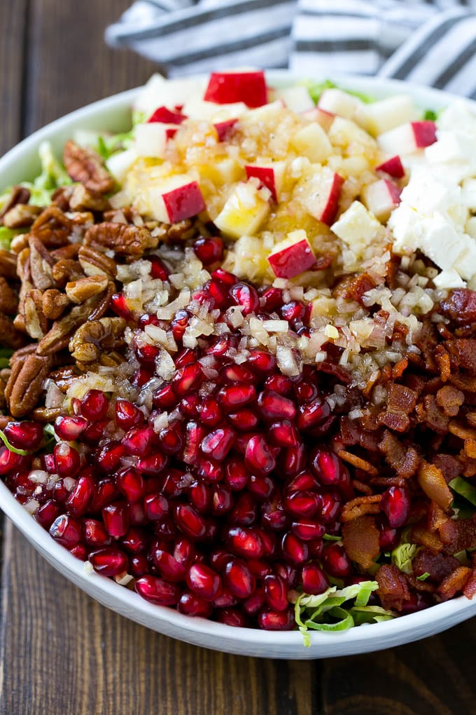Brussels sprout salad with pomegranate, pecans and feta cheese, all topped with a vinaigrette.