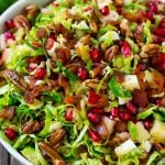 Brussels sprout salad with shredded brussels sprouts, pomegranate, pecans, feta cheese, apples and bacon.