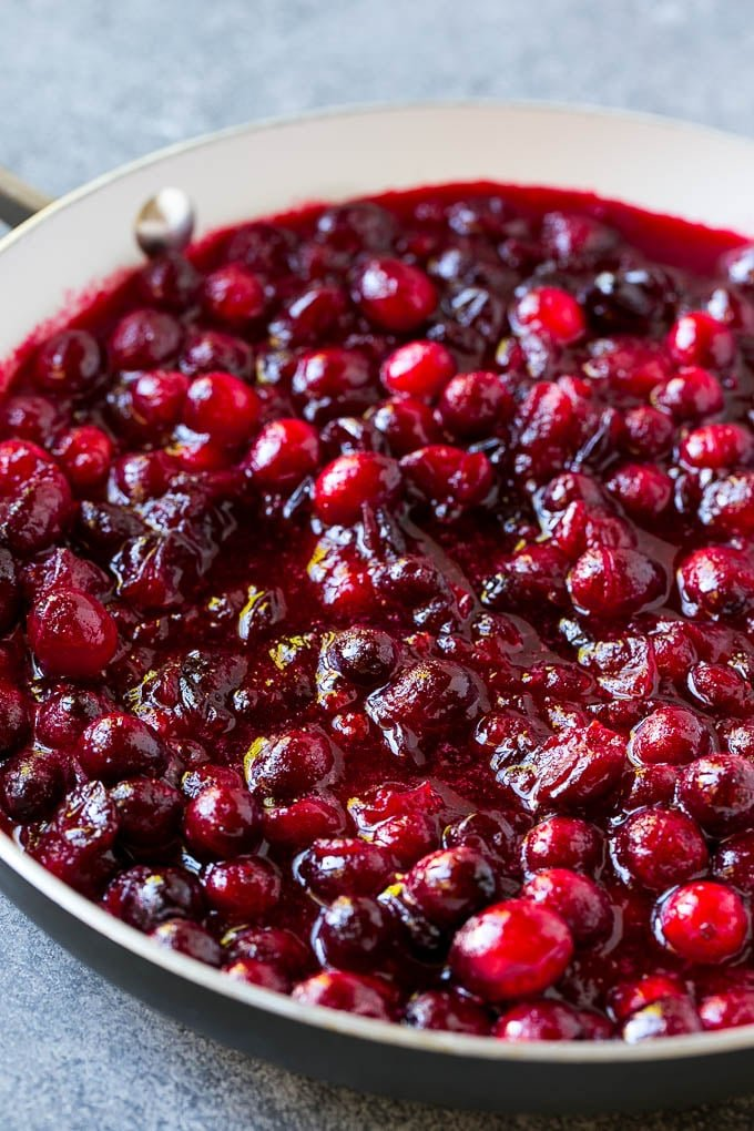 Cranberry orange sauce simmering in a skillet.