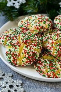 A plate of gooey butter cookies covered in holiday sprinkles.