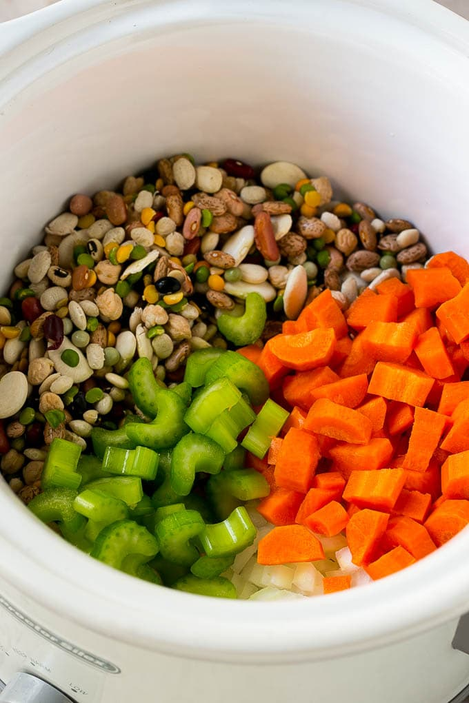 Dried beans, carrots, onions and celery in the slow cooker.